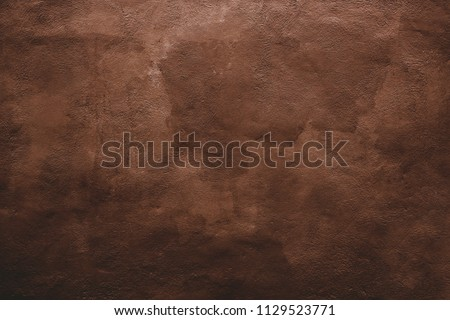 Grunge brown wall. Background texture of an painted wall #1129523771