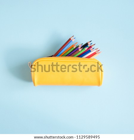 Colored different school supplies on soft  blue paper background. Back to school background. Flat lay, top view, copy space Royalty-Free Stock Photo #1129589495