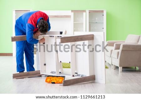 Repair contractor repairing broken furniture at home #1129661213