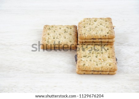 Sandwich calcium cracker with chocolate cream inside #1129676204
