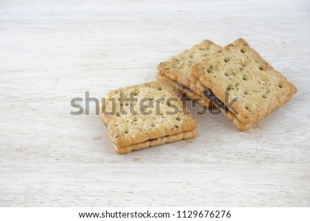 Sandwich calcium cracker with chocolate cream inside #1129676276