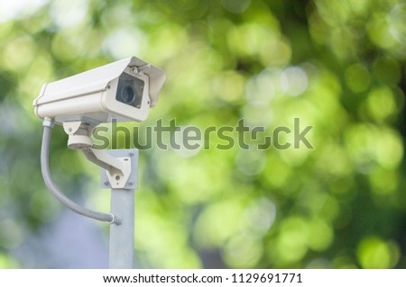 Cctv cameras on a pole, with the background Bokeh blur. Security #1129691771