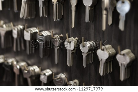 Several Keys type such as household and car key use for copying or duplicating hang on the wall in the locksmith workshop #1129717979