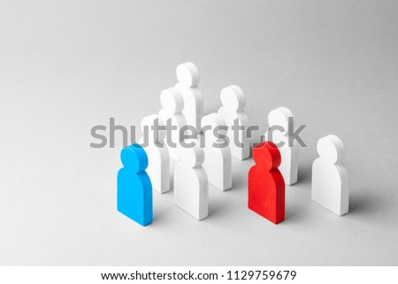 Concept leader of the business team indicates the direction of the movement towards the goal. Crowd of white men goes for the leader of the blue color and  bad conflicting employee of  red color #1129759679