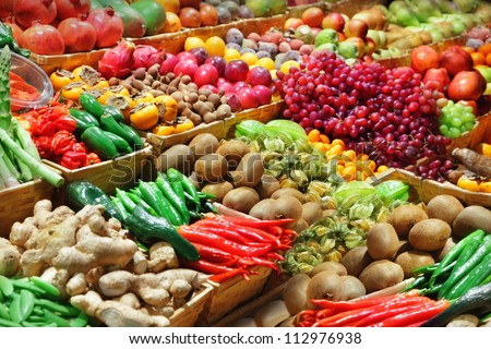 Fruits and vegetables at a farmers market #112976938