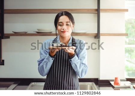 Asian barista women smelling coffee #1129802846