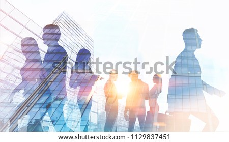 Silhouettes of business people walking and talking against a modern cityscape. Toned image double exposure mock up #1129837451