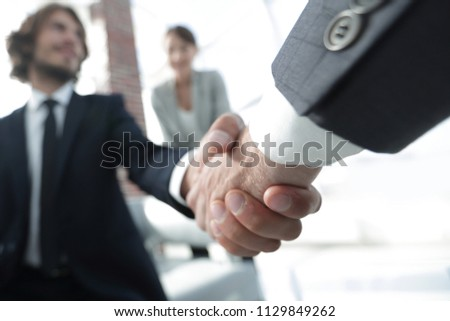 Closeup of a business hand shake #1129849262