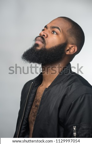 A portrait of a bearded young african man Royalty-Free Stock Photo #1129997054