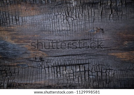 BBQ background. Burnt wooden Board texture. Burned scratched hardwood surface. Smoking wood plank background. Dark Burned wooden texture empty horizontal surface, copy  space #1129998581