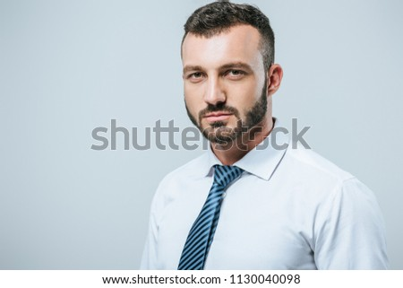 portrait of businessman looking at camera isolated on grey #1130040098