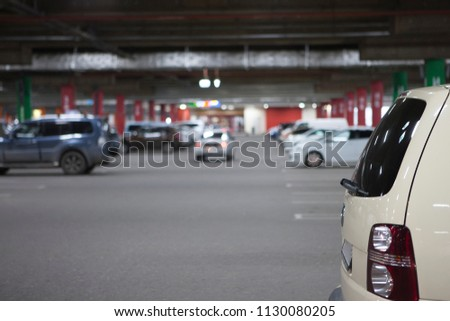 Underground parking is a large shopping center. There are not many cars. The image can be used as a background, there is room for text placement #1130080205