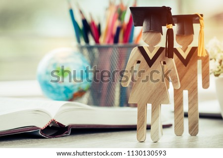 Australia Education knowledge learning study abroad international Ideas. People Sign wood with Graduation celebrating cap on open textbook with model global map, alternative studying world wide #1130130593