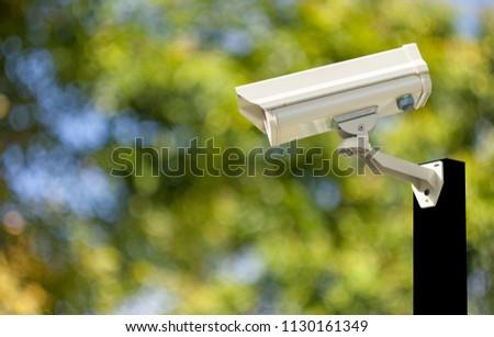 Cctv camera systems on pole background bokeh blur technology #1130161349