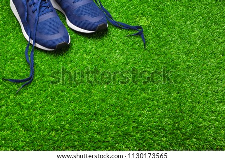 Sport shoes on grass #1130173565