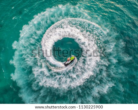 People are playing jet ski at sea during the holidays. Aerial view and top view. #1130225900