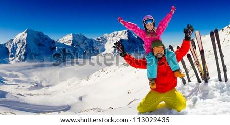 Winter, snow, sun and fun - family enjoying winter vacations