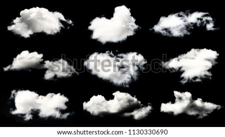 Collection of white clouds isolated on black background. Design elements.. #1130330690