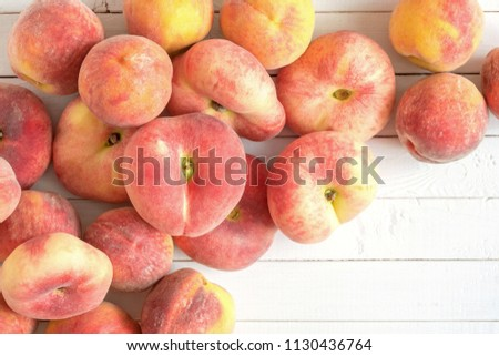 Ripe juicy peaches on a wooden white background. Fruit summer background. Flat lay, top view, copy space #1130436764