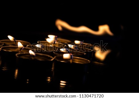 burning candles on black background #1130471720
