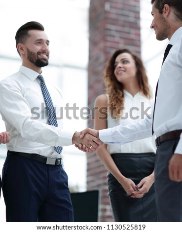 closeup.welcome and handshake of business partners #1130525819
