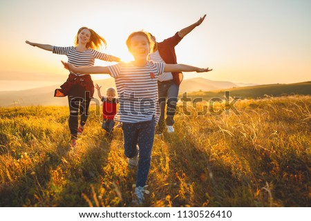 Happy family: mother, father, children son and  daughter on nature  on sunset #1130526410