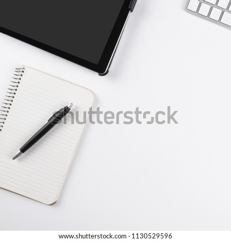 Flat Lay view of a white business desk with pad, tablet, computer, and keyboard with copy space. #1130529596