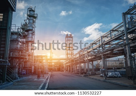Pipeline and pipe rack of petroleum industrial plant with sunset sky background #1130532227