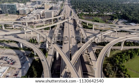 Ariel View of I-10 Freeway intersecting with Beltway 8 in Houston Texas. Royalty-Free Stock Photo #1130642540