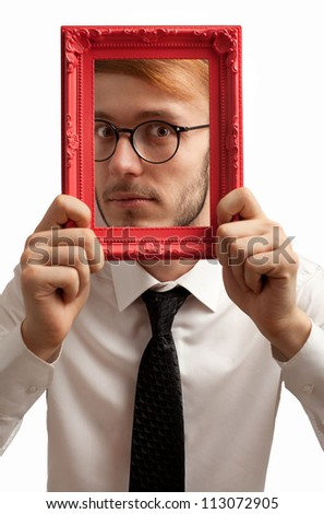 nerdy businessman holding a frame isolated on white