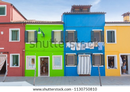 Rectilinear view of the colored facades of buildings on the island of Burano, near Venice, Italy #1130750810