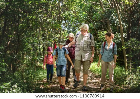 Family hiking in a forest #1130760914