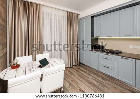 Modern kitchen, minimalistic clean design. some doors open #1130766431