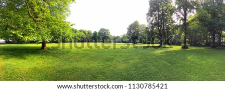 Building land for new construction project on green meadow, plot for construction area Royalty-Free Stock Photo #1130785421