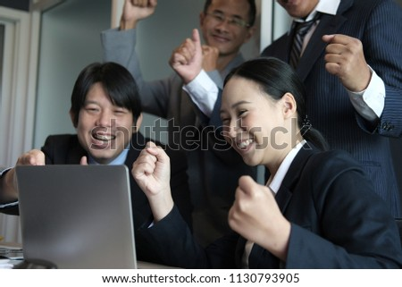 business team raise hands with happiness for successful project. cheerful asian businessman & businesswoman showing gladness for achievement #1130793905