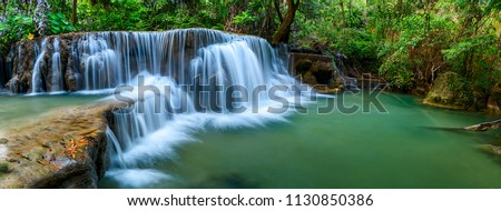 Panoramic waterfall in rainforest at National Park, Thailand. #1130850386