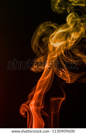 colorful smoke on dark background #1130909600