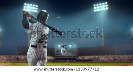 Baseball player bat the ball on professional baseball stadium #1130977712