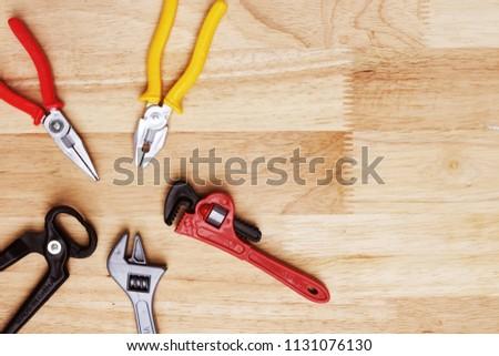 Toy Tool on wooden floor Text input area #1131076130
