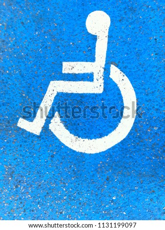 Wheelchair parking lot symbol. Painted parking space for handicapped. #1131199097