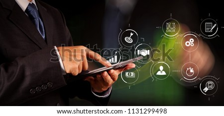 Business process management with workflow automation diagram and gears in virtual flowchart.businessman success working computer touch screen with his team as concept  #1131299498
