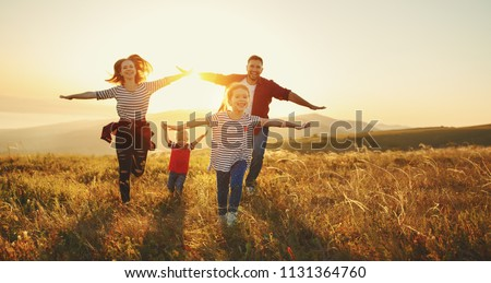 Happy family: mother, father, children son and  daughter on nature  on sunset #1131364760