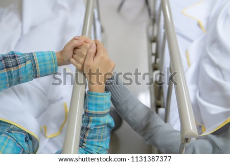 Female patients in bed, holding hands, encouraging each other to treat injuries after an accident. Medical and healthcare concept #1131387377