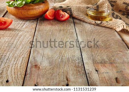 Italian Food on Old Wooden Background with Selective Focus. Table Top Perspective with Tomatoes, Basil and Olive Oil with Place for Text. Blurred Vintage Aged Boards Texture #1131531239