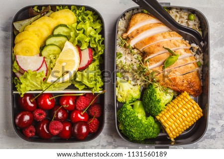 Healthy meal prep containers with grilled chicken with fruits, berries, rice and vegetables. Takeaway food on white background, top view #1131560189