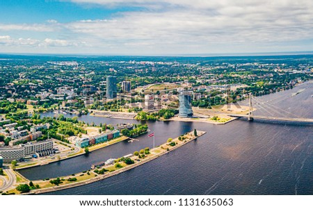 July 2, 2018. Riga, Latvia. Aerial view of Riga city - capital of Latvia. Amazing view on the river Daugava, old town, national library, bridges over the river and the main TV tower. #1131635063