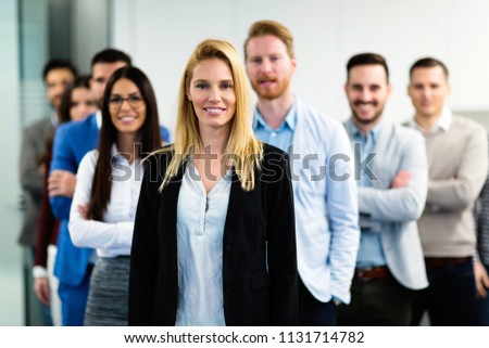 Successful team of young perspective businesspeople in office #1131714782