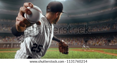 Baseball player throws the ball on professional baseball stadium #1131760214
