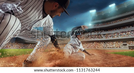 Baseball players on professional dramatic stadium. Baseball tagged out #1131763244