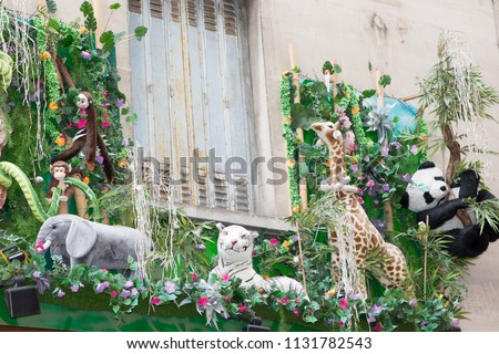 an apartment balcony decorated in jungle with plush animals #1131782543